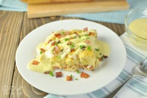 One serving of Eggs Benedict Casserole on a white plate