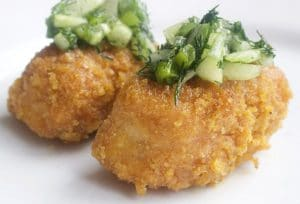 two pieces of Baked Fish Sticks with Cucumber Dill Relish
