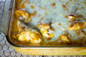 close up of creamy tomato chicken & spaghetti squash casserole in a glass dish