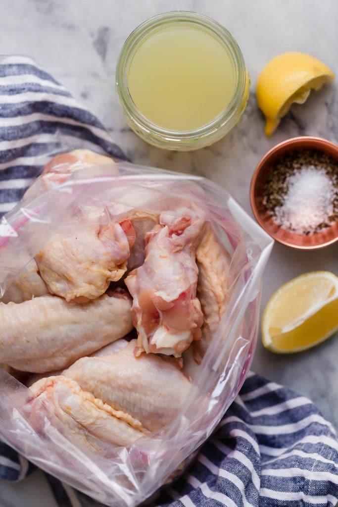 large ziplock plastic storage bag, add chicken wings, lemon juice, avocado oil