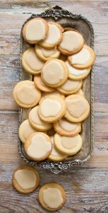 vintage tray filled with keto shortbread cookies on a rustic wood surface
