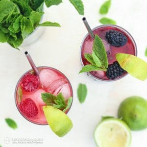 top view of two glasses of raspberry and blackberry mojitos