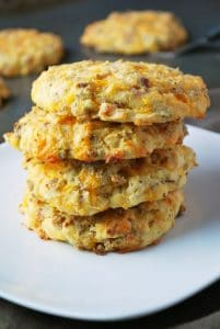 Stack of 4 savory breakfast cookies on a white plate