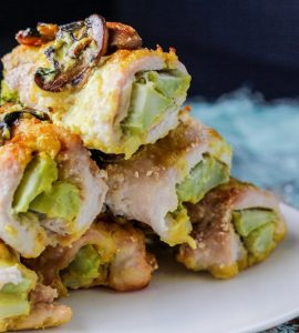 Turmeric Broccoli Chicken Rollups stacked on a plate