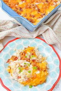one serving of loaded cauliflower casserole on a multicolored plate