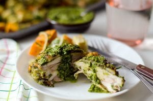 a serving of Chimichurri Marinated Chicken on a plate with a knife and fork