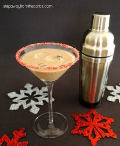 martini glass with low carb chocolate peppermint cocktail and snowflakes on the table