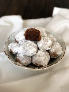 bowl filled with chocolate snowball cookies