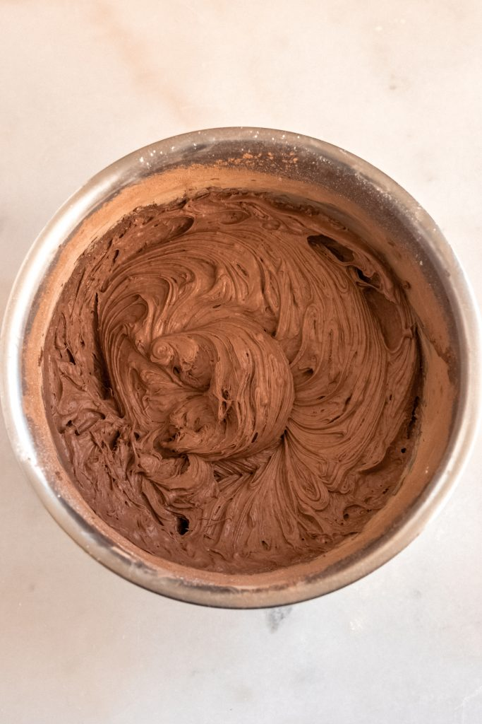 keto chocolate pudding ingredient well-combined in a mixing bowl