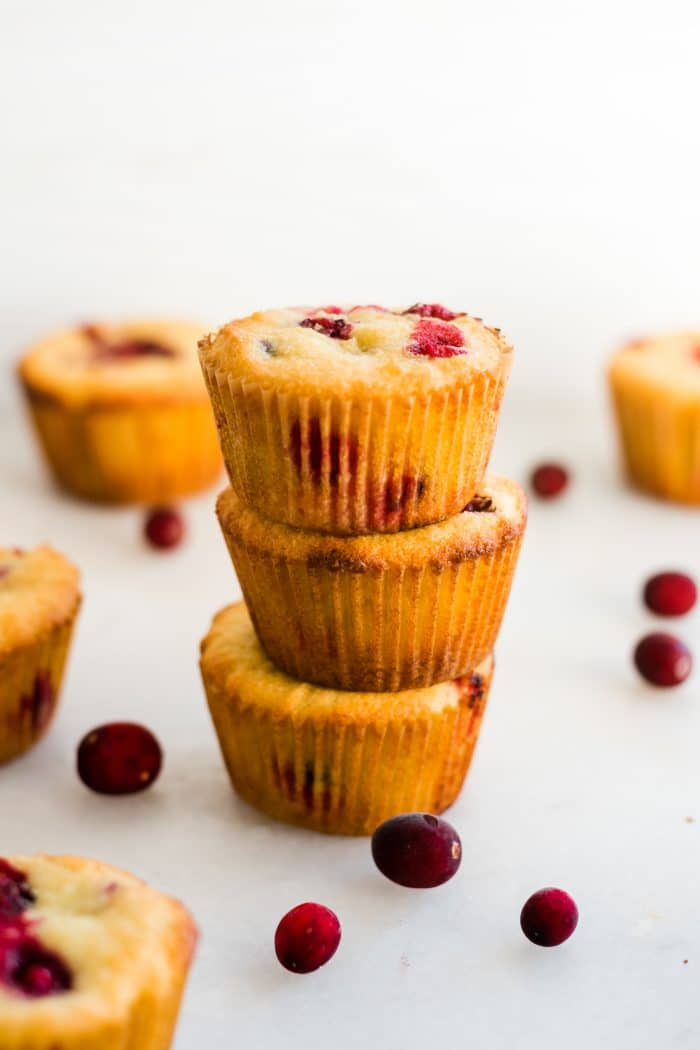 a stack of 3 keto cranberry orange muffins