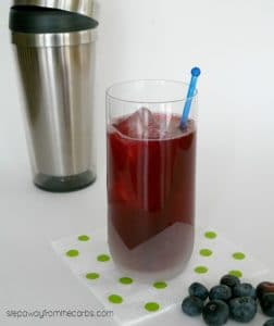 low carb blueberry cooler on a green polka dot napkin