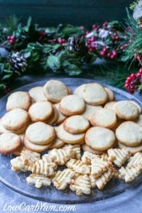 plate FILLED with cream cheese cookies with christmas wreath in background