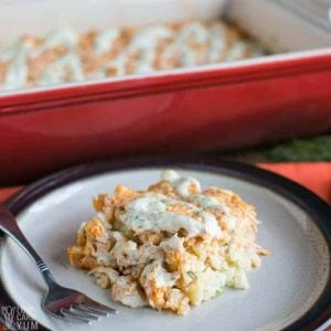One serving of low carb paleo buffalo chicken casserole on a plate with fork