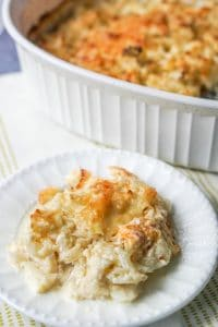 Cheesy cauliflower casserole on a white plate