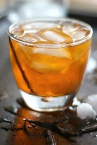 closeup of a glass of vanilla old fashioned cocktail