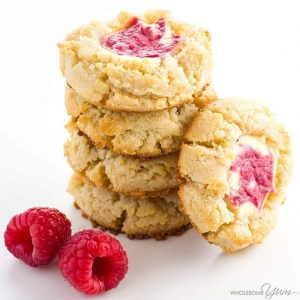 stack of raspberry cheesecake cookies with raspberries to garnish