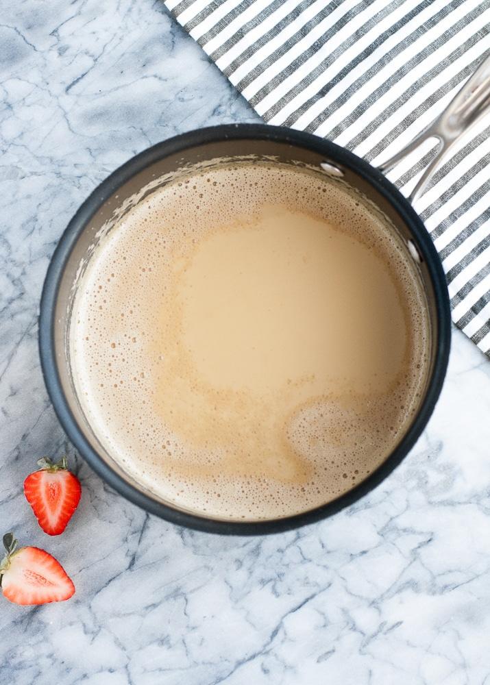 heated mixture of heavy cream, monk fruit sweetener, gelatin powder, and espresso powder in a saucepan