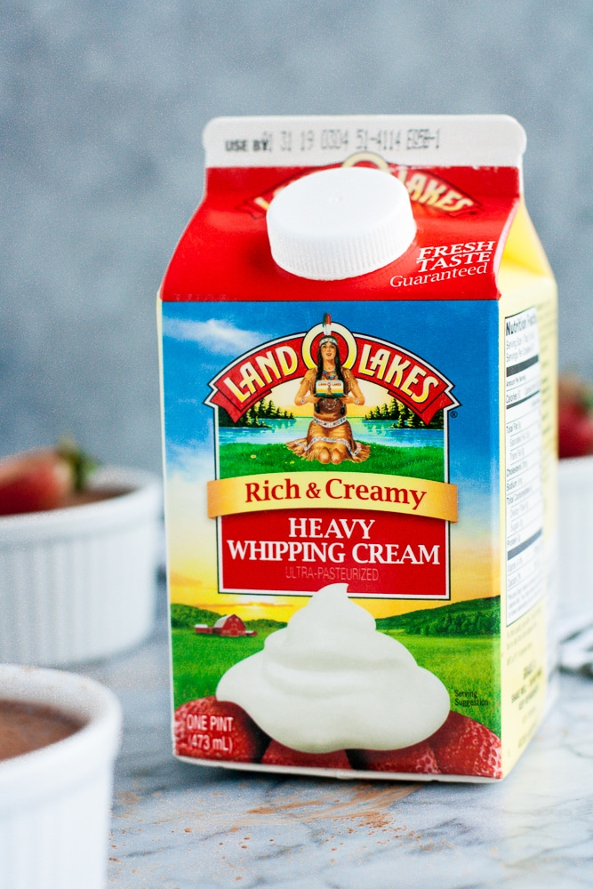 a carton of land o lakes rich and creamy heavy whipping cream on top of a marble kitchen counter