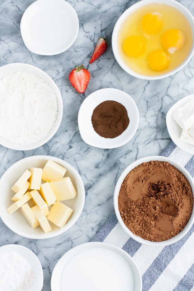 Low Carb Chocolate Strawberry Cupcakes ingredients neatly assembled on a kitchen counter