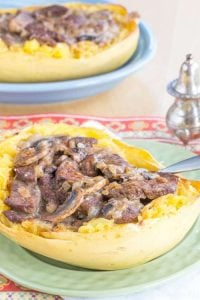 2 Skinny Beef Stroganoff Stuffed Spaghetti Squash on multi colored plates