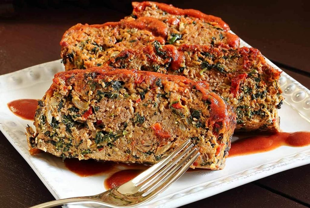 Zesty Paleo Meatloaf on a square plate beside a fork