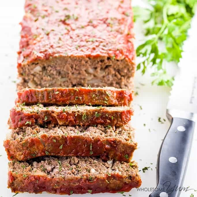 Paleo Keto Low Carb Meatloaf beside a bread knife