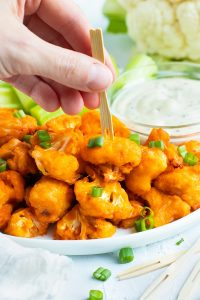 buffalo cauliflower bites skewered with a toothpick