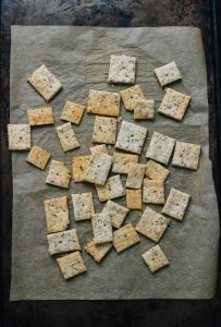 3-ingredient homemade almond crackers on a baking sheet