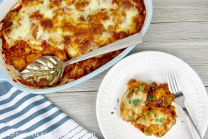 chicken parmesan casserole dish with one serving on a plate