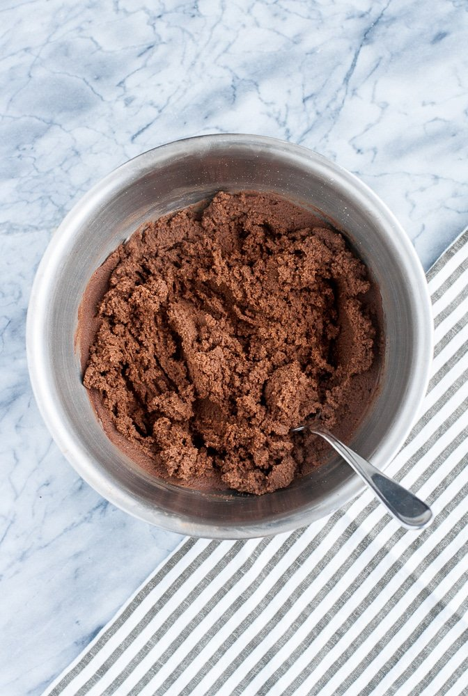Chocolate Truffle Fat Bombs with CBD isolate powder mixed together in a stainless steel mixing bowl