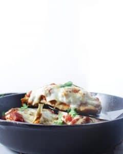 side view of easy keto chicken parmesan on a spatula