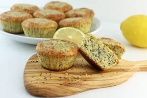 keto lemon poppyseed muffins on a wooden paddle