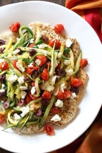 Pork chops with veggies piled high on top