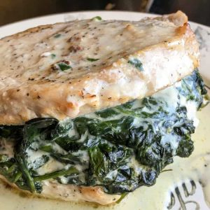 close-up of creamed spinach stuffed keto pork chops