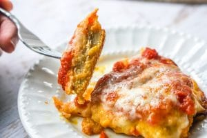low carb chicken parmesan cut with fork
