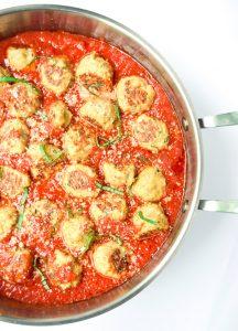 keto chicken parmesan meatballs in a metal pot