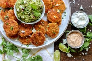 low carb fajita chicken nuggets on a plate with guacomole and dips