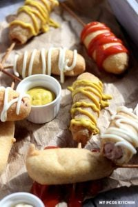 gluten-free corn dogs with mustard ketchup and mayo