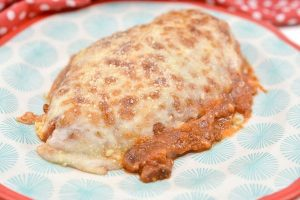 easy keto chicken parmesan on a patterned plate
