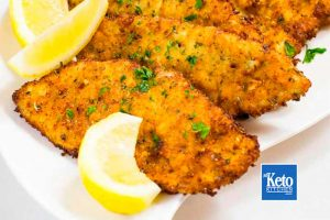 keto schnitzels with lemon wedges