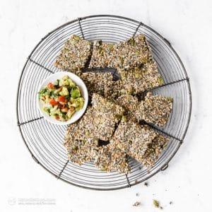 crispy multi-seed keto crackers on a cooling rack