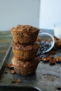 three keto pecan muffins stacked on top of each other