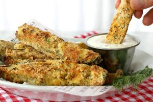 cajun oven-baked pickles dipped in dipping sauce