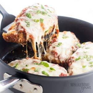 low carb keto chicken parmesan being scooped out of a skillet
