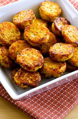 multiple cheesy cauliflower tots in a square dish