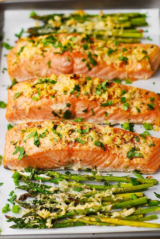 parmesan garlic crusted salmon and asparagus on a parchment lined pan