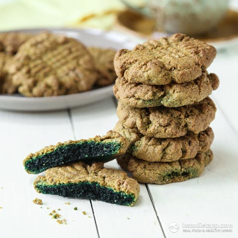stack of 5 ingredient keto green cookies with one broken open beside