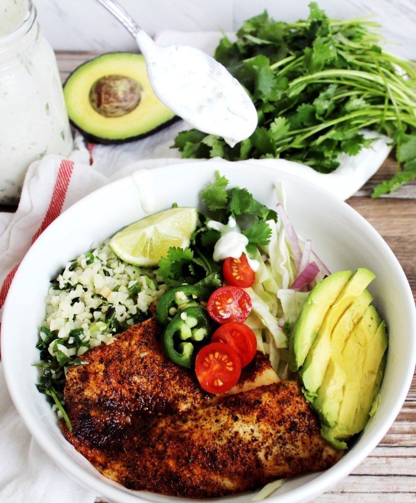 low carb fish taco bowl with ingredients in the background