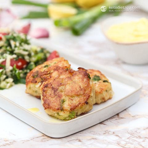 keto fish cakes on a plate with salad on the side