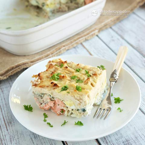 one slice of keto fish pie in a white plate with a fork